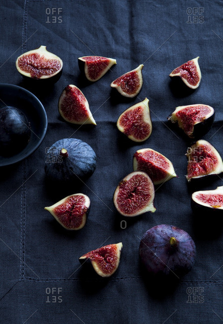 Several fresh sliced figs arranged on a table