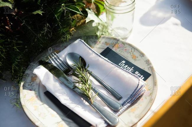 Place setting with herbs and thank you card