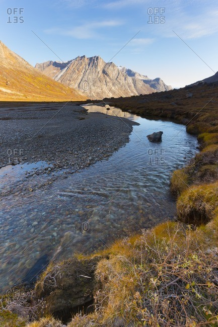 Mountain landscape reflecting in a river in Greenland