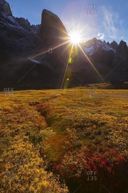 Sunburst over mountain in Greenland