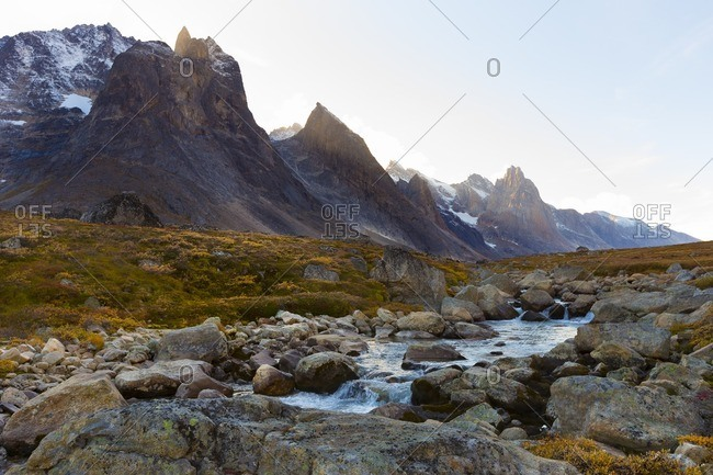 Mountain by rocky river in Greenland