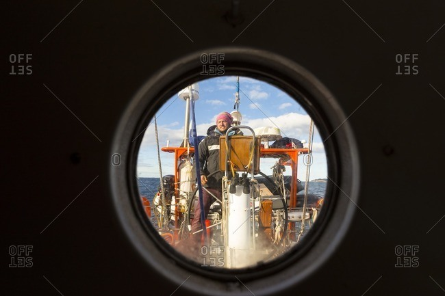 Greenland - September 26, 2016: Captain steering a sailboat
