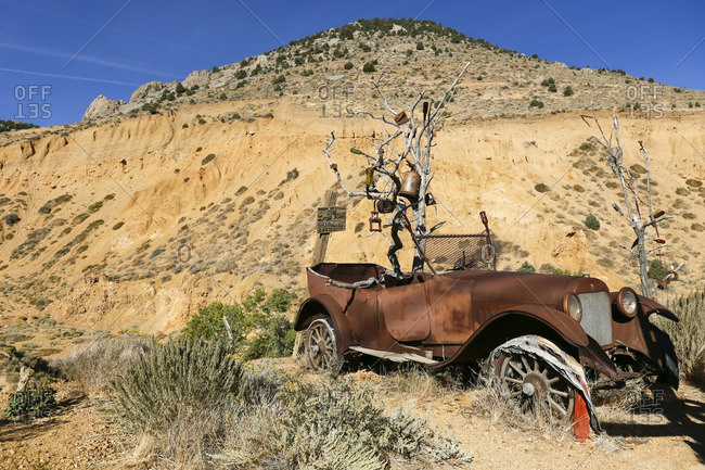 A rusted vintage car abandoned in the ghost town