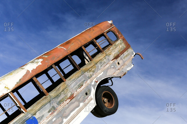 Abandoned bus turned on end as a folk art sculpture