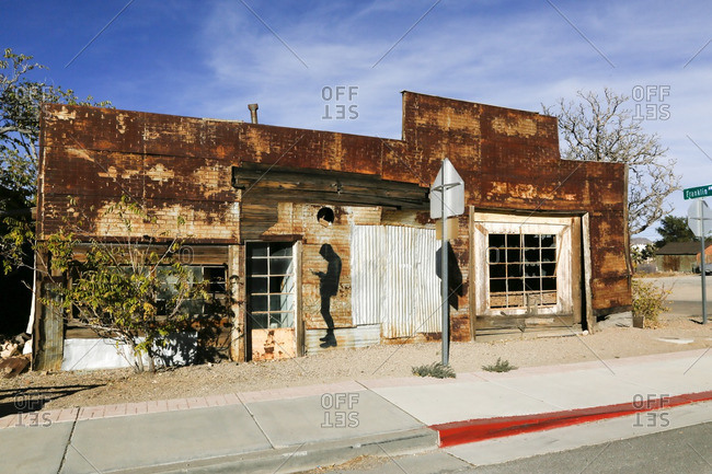 Goldfield, Nevada - October 8, 2016: Abandoned storefront with a painting of a man's shadow