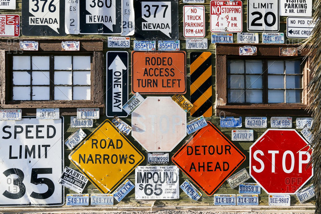 Goldfield, Nevada - October 9, 2016: Close-up of a business adorned with road signs
