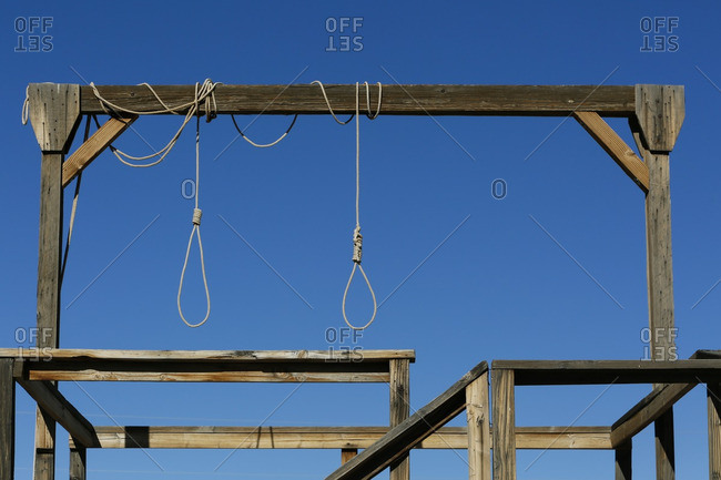 Rope hanging from a wooden structure