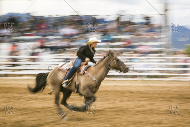 Taos, New Mexico - June 28, 2015: Cowgirl during a barrel race