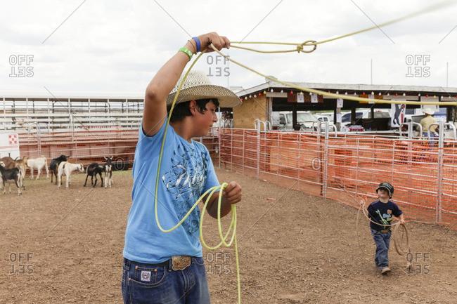 Galisteo, New Mexico - June 28, 2015: Boys practicing lasso skills