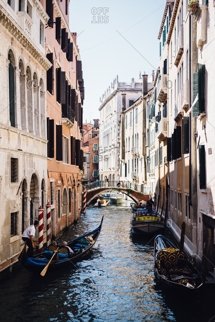 Venice, Italy - August 31, 2016: Gondolas on a canal in Venice