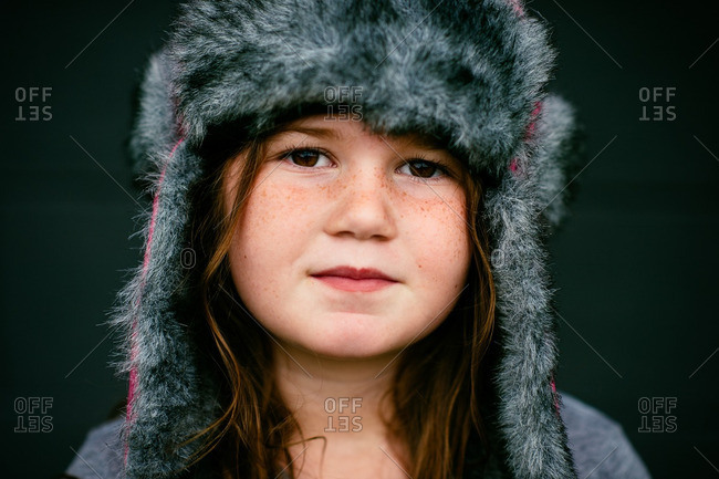 Portrait of a girl in a furry hat