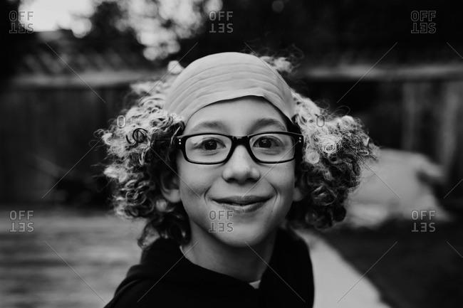 Boy wearing bald man wig on Halloween