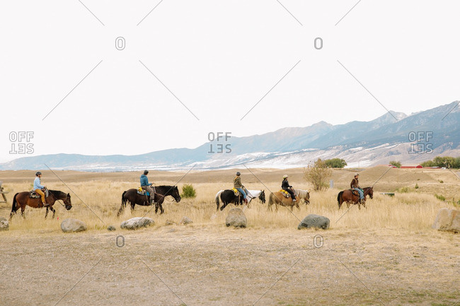 People on horseback in rural Montana