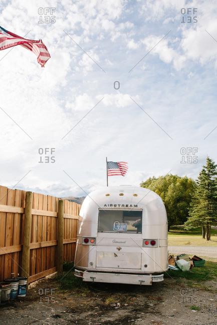 A camper van with American flags