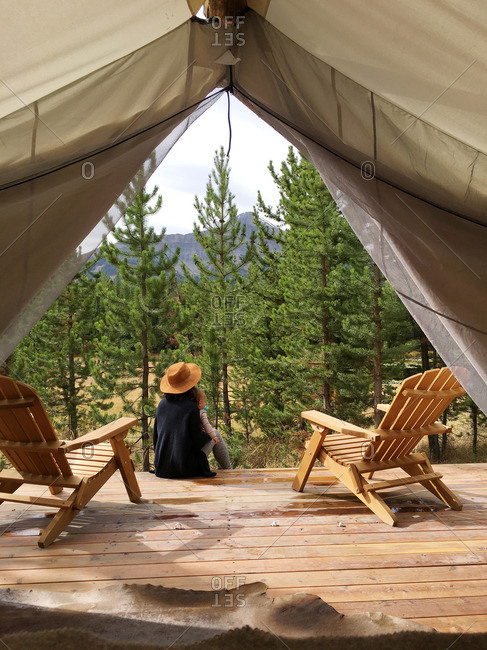 Woman in teepee tent in Montana