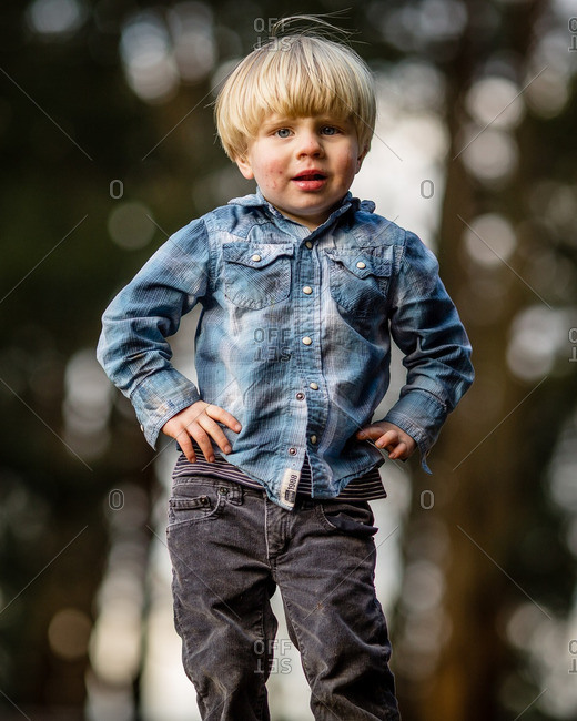 Toddler boy standing like a man