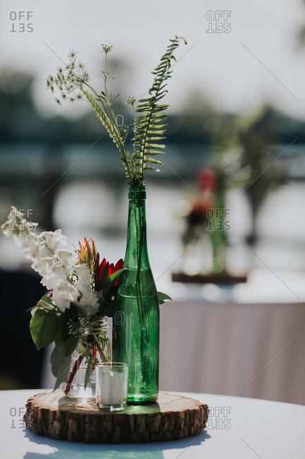 Flowers in bottles on wedding table