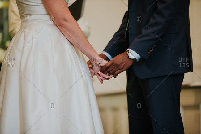 Interracial bride and groom getting married