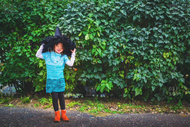 Young girl dressed up as a witch for Halloween