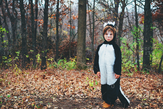 Young boy dressed up as a skunk for Halloween
