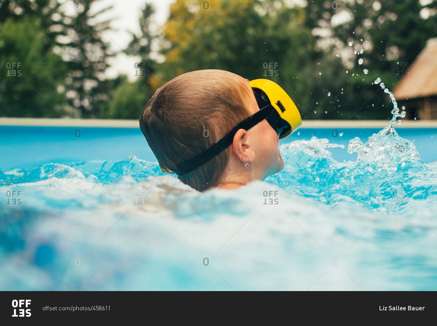 Pool Bauer boy 6 7 years swimming in swimming pool stock photo offset