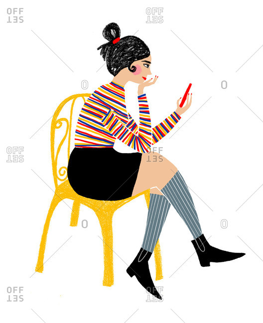 Woman in yellow chair using smartphone