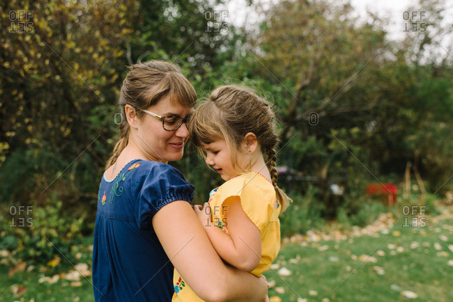 Mom and girl in embroidered shirts