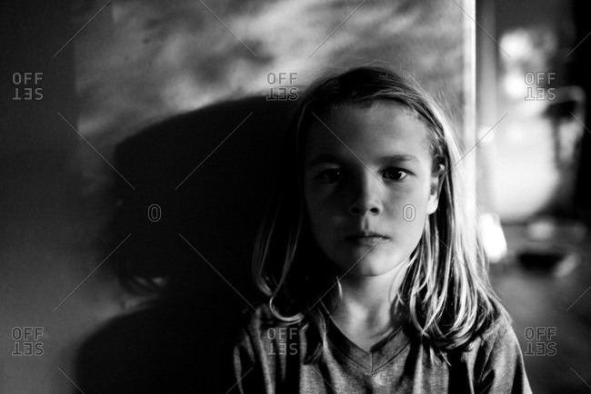 Boy with long hair in evening light