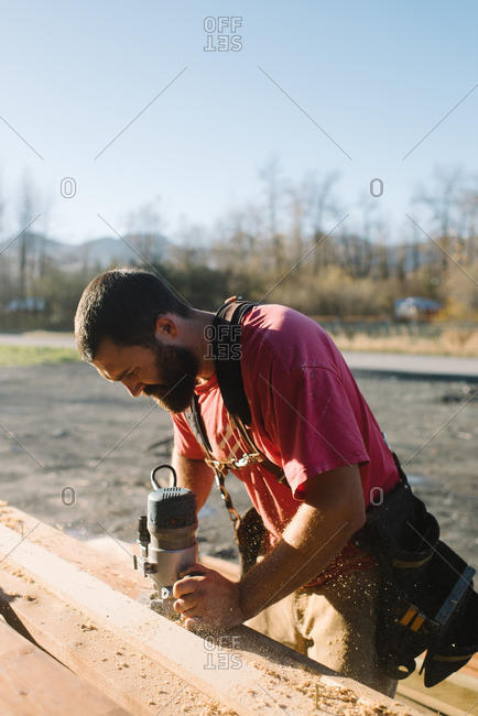 Man sanding board for construction