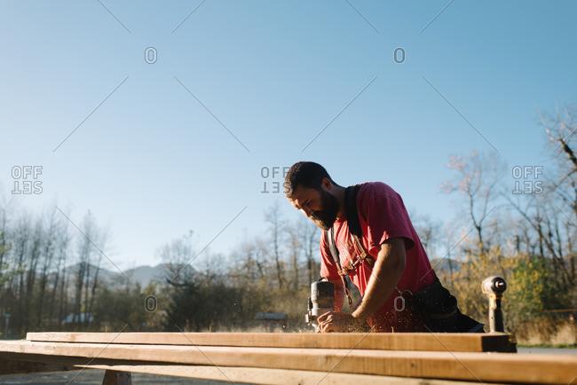 Man sanding a wood board