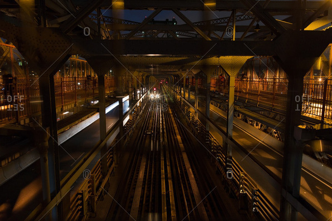 Brooklyn, New York - August 16, 2016: View of train pulling into station in Brooklyn at night