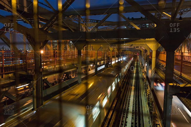 Brooklyn, New York - August 16, 2016: View of moving train at a subway station in Brooklyn at night