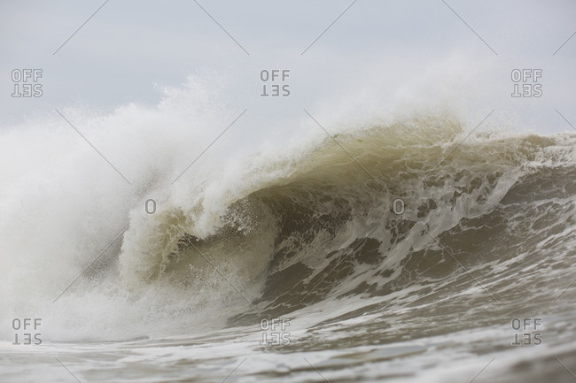 Foamy crashing wave in the Atlantic ocean