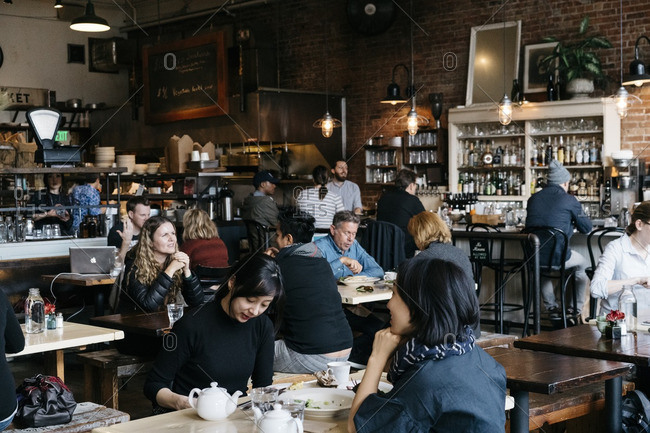 Seattle, Washington - October 18, 2016: People enjoying food and drinks at Oddfellows Cafe+Bar in Seattle