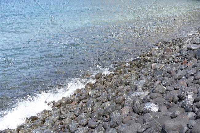 Waves crashing on the rocky coast of the Big Island, Hawaii