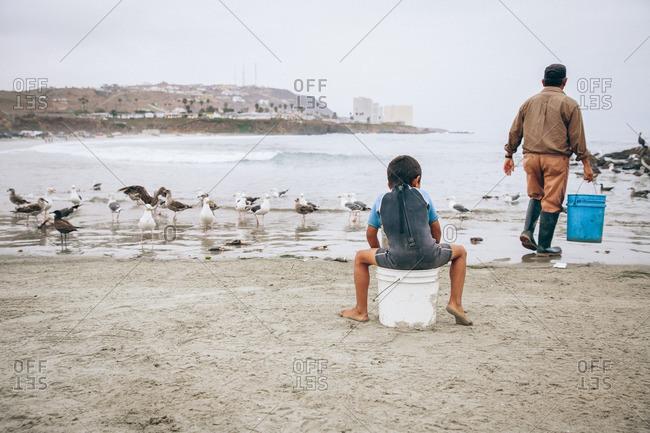 Fisherman with his son on Popotla beach in Baja, Mexico