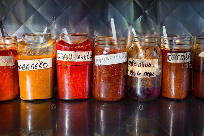 Variety of homemade salsa in jars