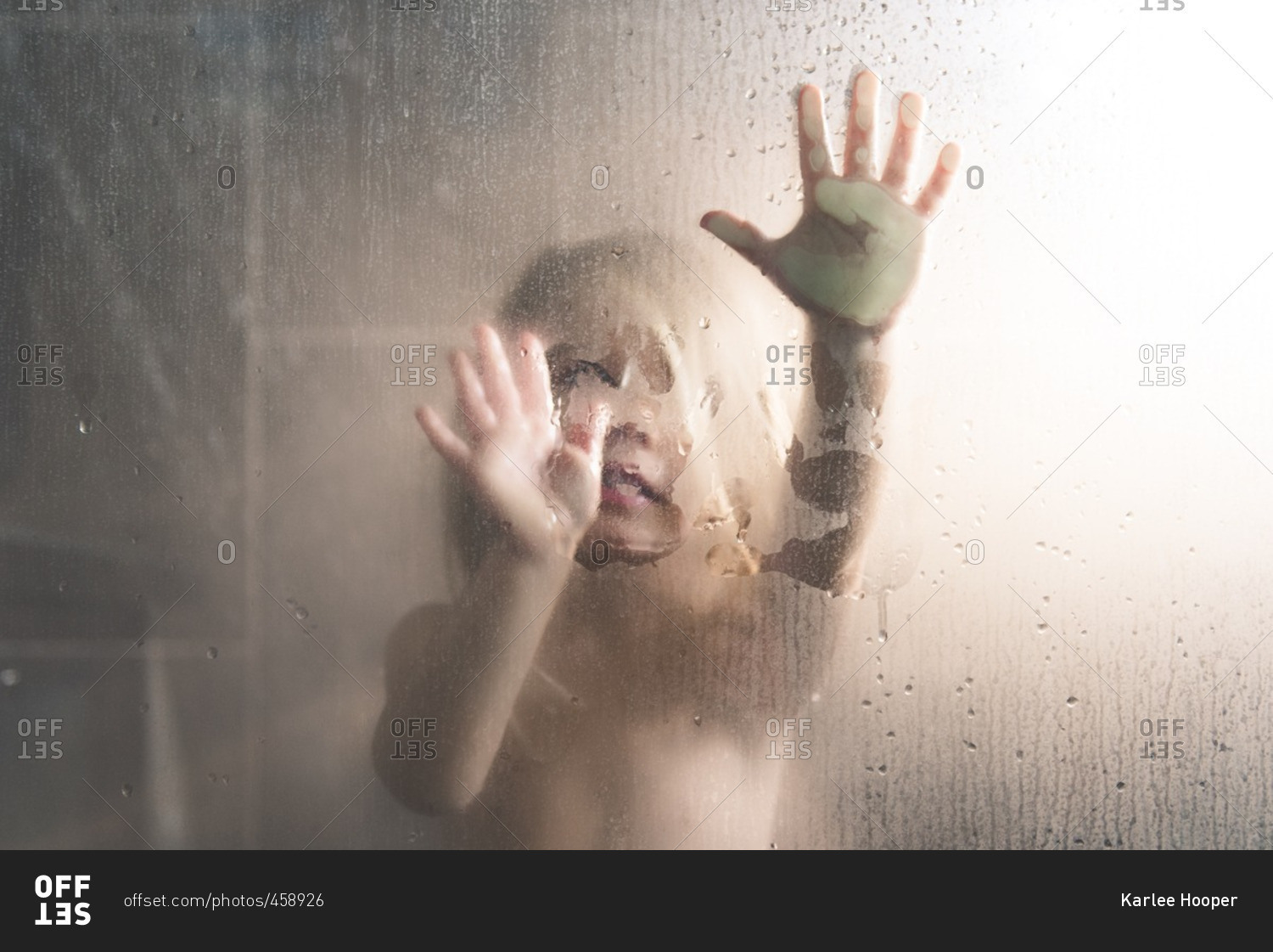 toddler girl pressing hands on glass in the shower stock bathroom glass doors and windows bathroom glass doors at home depot