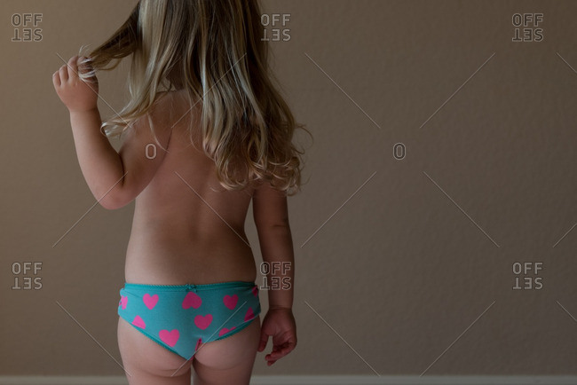 Little girl wearing blue panties with pink hearts
