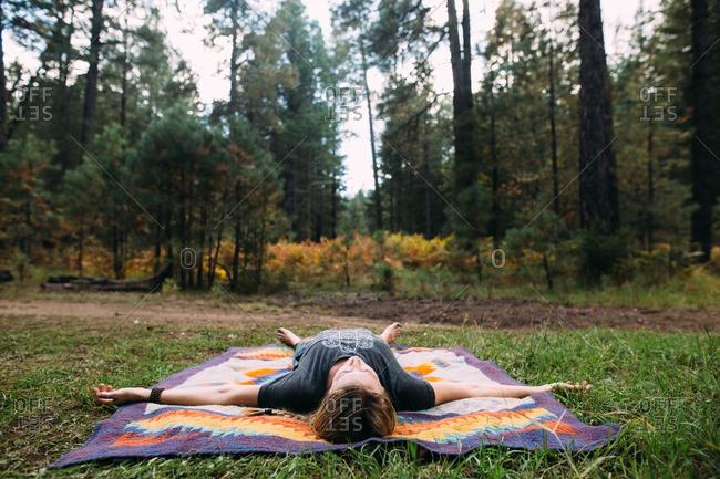 Woman lying in meditative pose