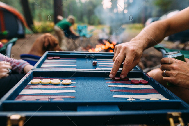 People playing backgammon at campsite