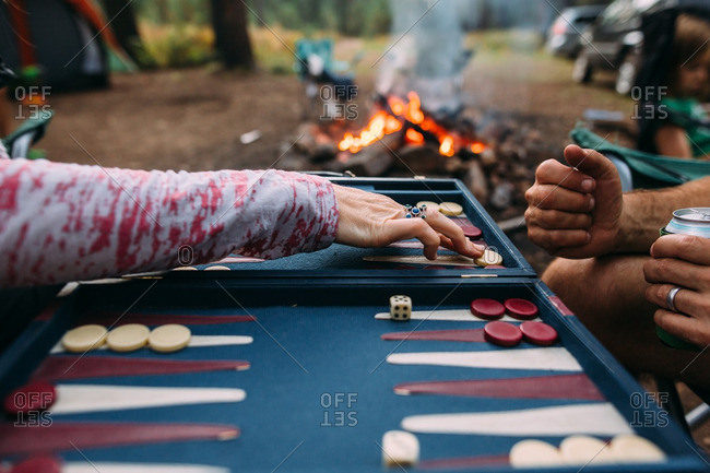 Two people playing a backgammon game