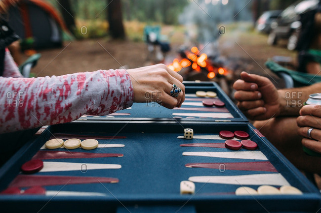 Two people playing backgammon game