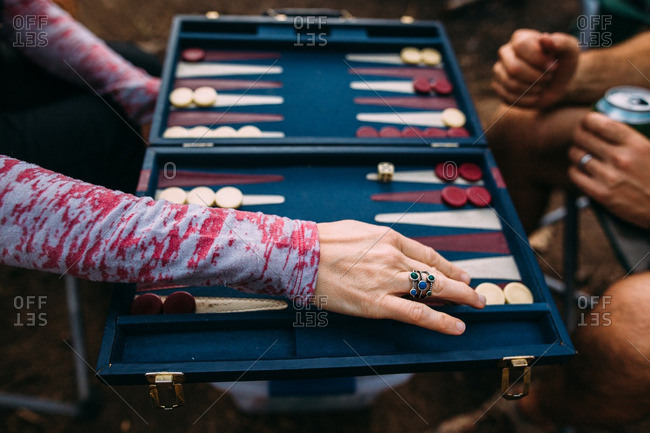 Two people playing game of backgammon