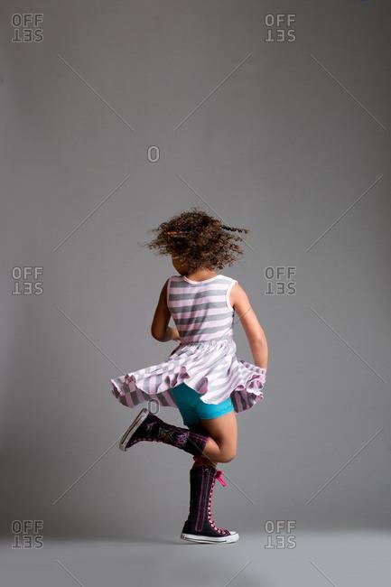 Girl twirling in studio shot