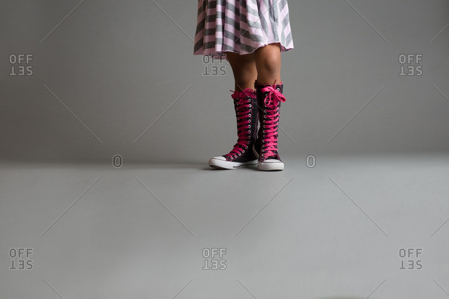 Girl wearing high top canvas shoes