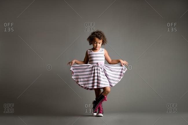 Girl curtsying in studio shot