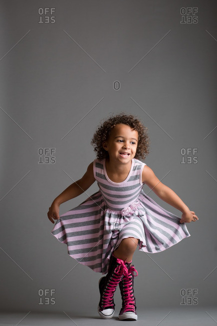 Girl doing curtsy in studio shot