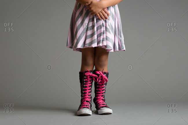 Girl wearing high top canvas boots