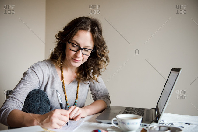 Woman writing on a note card
